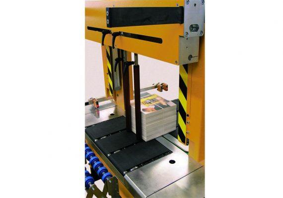 Umreifungsmaschine Strapex SMG Transit Niederhalter Zeitschriften